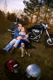 Beautiful couple in motorcycle Stock Photography