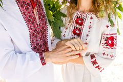 Beautiful couple in national Ukrainian embroidered shirts shirt. Beautiful couple in national Ukrainian embroidered shirts shirt, in sunset stock images