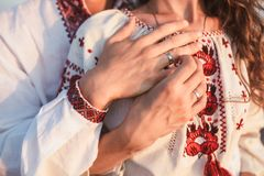 Beautiful couple in national Ukrainian embroidered shirts shirt. Beautiful couple in national Ukrainian embroidered shirts shirt, in sunset royalty free stock image