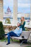 Beautiful couple near columns against background of European autumn landscape Stock Photos