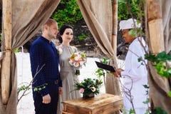 Beautiful couple near the ocean, honeymoon romantic couple royalty free stock photos