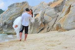 Beautiful couple of newlyweds at the beach Royalty Free Stock Images