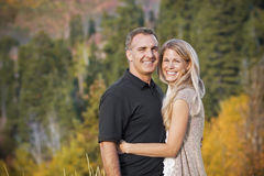 Beautiful Couple Outdoors Portrait. A Beautiful Middle-Aged Couple portrait outdoors with fall colors in the background. Lots of copy Space Royalty Free Stock Photos