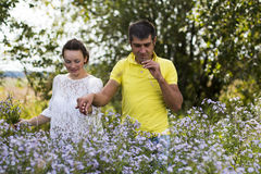Beautiful couple outdoors in a summer Stock Photography