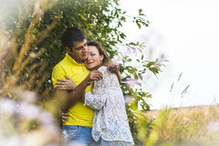 Beautiful couple outdoors in a summer Royalty Free Stock Images