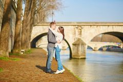 Beautiful couple in Paris walking by the Seine Royalty Free Stock Photography