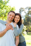 Beautiful couple in the park. Beautiful joyful couple in the park Royalty Free Stock Photos