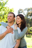 Beautiful couple in the park. Beautiful joyful couple in the park Stock Image