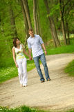 Beautiful couple in a park Royalty Free Stock Image