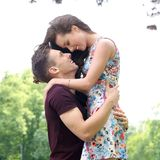 Beautiful couple in the park. Cute, young couple in the park Royalty Free Stock Image