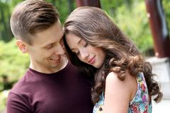Beautiful couple in the park. Cute, young couple in the park Royalty Free Stock Photos