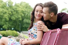 Beautiful couple in the park. Cute, young couple in the park Stock Photo
