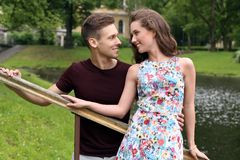 Beautiful couple in the park. Cute, young couple in the park Stock Photos