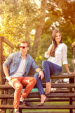 Beautiful couple in park. Beautiful  fashion couple in park Royalty Free Stock Photo