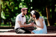 Beautiful couple in park. Beautiful couple having fun in the park Stock Photo