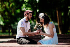 Beautiful couple in park. Beautiful couple having fun in the park Stock Photography