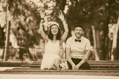 Beautiful couple in park. Beautiful couple having fun in the park, instagram toned Royalty Free Stock Photography