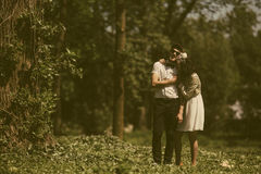 Beautiful couple in park. Beautiful couple having fun in the park, instagram toned Royalty Free Stock Images