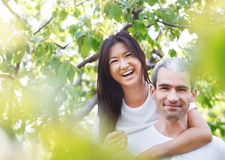 Beautiful couple at the park looking very happy Stock Photos