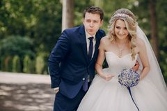 Beautiful couple in a Park. On a Sunny canopy at his wedding Stock Photography