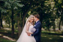 Beautiful couple in a Park. On a Sunny canopy at his wedding Royalty Free Stock Photography