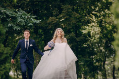 Beautiful couple in a Park. On a Sunny canopy at his wedding Royalty Free Stock Images