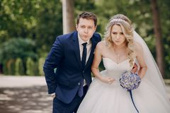 Beautiful couple in a Park. On a Sunny canopy at his wedding Stock Photo