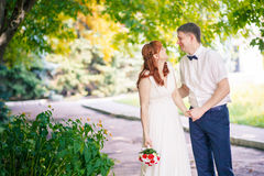 Beautiful couple in the park wedding. The beautiful couple in the park wedding Royalty Free Stock Photos