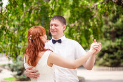 Beautiful couple in the park wedding. The beautiful couple in the park wedding Stock Photo