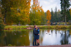 Beautiful couple in the park. Young couple walking in the autumn park Royalty Free Stock Photo
