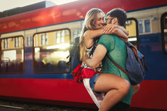 Beautiful couple parting at train station. Beautiful couple reunion /separation at train station Stock Images