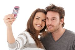 Beautiful couple photographing themselves smiling Royalty Free Stock Image