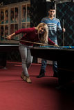 Beautiful Couple Playing Pool stock image