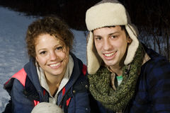 Beautiful couple playing in the snow together Royalty Free Stock Photo