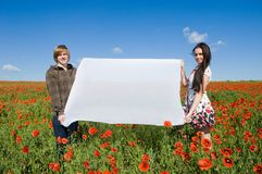 Beautiful couple in the poppy field Royalty Free Stock Photos
