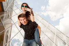Beautiful couple posing in fashion style in front of glass build Royalty Free Stock Photography
