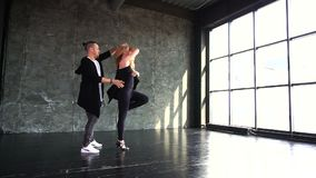 Beautiful couple of professional artists dancing passionate dance. Slow-motion. latin dance stock video footage