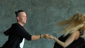 Beautiful couple of professional artists dancing passionate dance. Slow-motion. hispanic dancer stock video footage