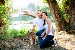 Beautiful couple with puppy Stock Photography