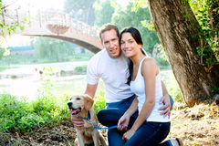 Beautiful couple with puppy Stock Photo
