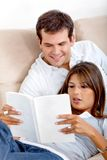 Beautiful couple reading Royalty Free Stock Image