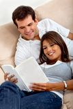 Beautiful couple reading Stock Photos