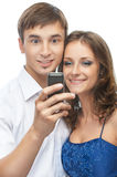 Beautiful couple reading sms on phone Royalty Free Stock Photography