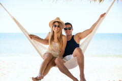 Beautiful couple relaxing in a hammock royalty free stock image