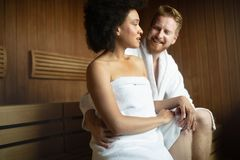 Couple relaxing in sauna and caring about health and skin stock image