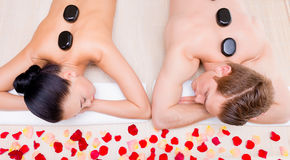 Beautiful couple relaxing in spa salon. Stock Photos