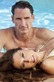 Beautiful Couple Relaxing By Swimming Pool Stock Photos