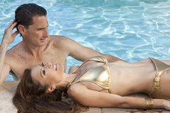 Beautiful Couple Relaxing By Swimming Pool Royalty Free Stock Photos