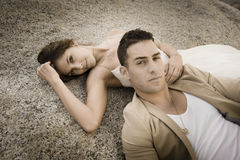 Beautiful couple relaxing of textured rock outdoors Royalty Free Stock Image
