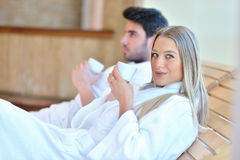 Beautiful couple relaxing together at spa centre after a beauty treatment Royalty Free Stock Photos